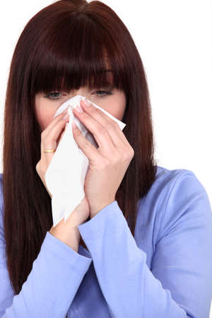 woman blowing her nose photo