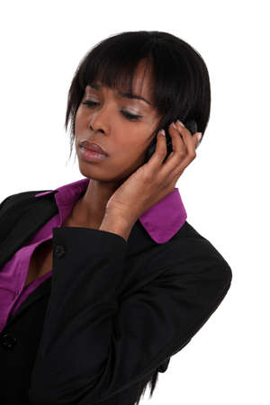 frustration girl: A sad businesswoman over the phone. Stock Photo