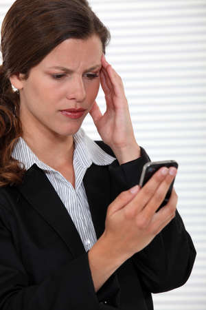 deceive: businesswoman receiving bad news on her cell