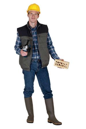 profess: Mason holding brick and angle grinder