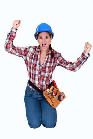 triumphant: Triumphant female construction worker Stock Photo
