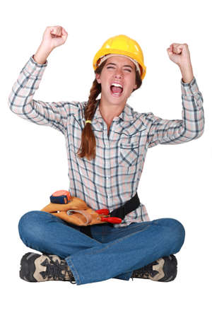 An ecstatic female construction worker. photo