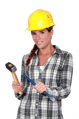 Tradeswoman holding a hammer and chisel Stock Photo - 11947222