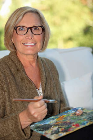 middle age woman: A middle age woman painting.