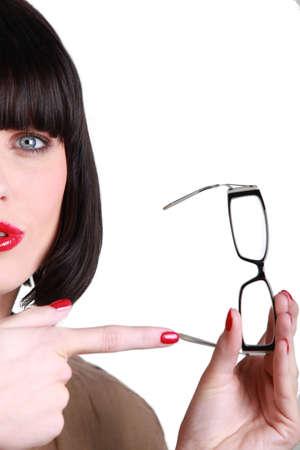 mecha: Woman pointing glasses Stock Photo