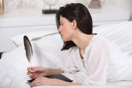 Woman writing with a feather Stock Photo - 11947368