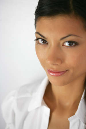 glowing skin: Close-up shot of a confident woman