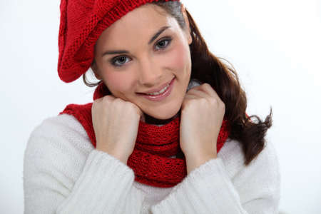 young woman wearing scarf and bonnet photo