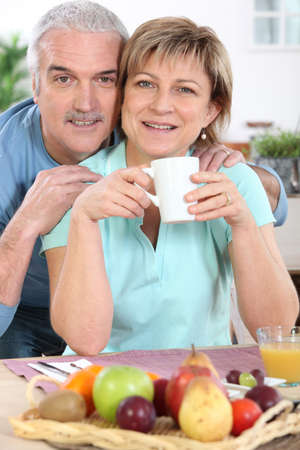 all smiles: mature couple all smiles at breakfast