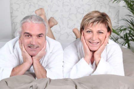 house robe: Couple lying in bed