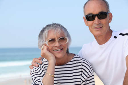 65 years old: Elderly couple by the seaside Stock Photo