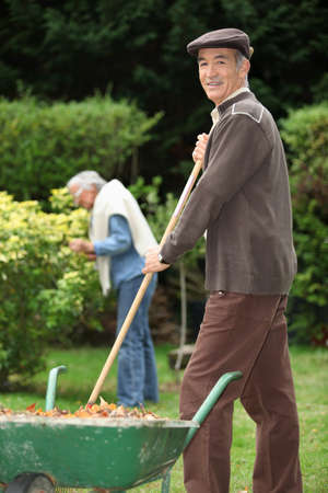 yard work: Elderly couple in their garden Stock Photo