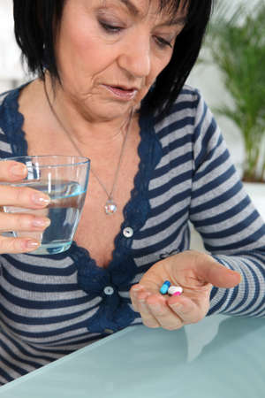 Mature woman taking drugs photo