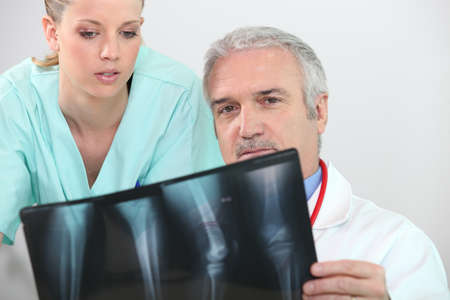 x rays negative: doctor and nurse examining a case