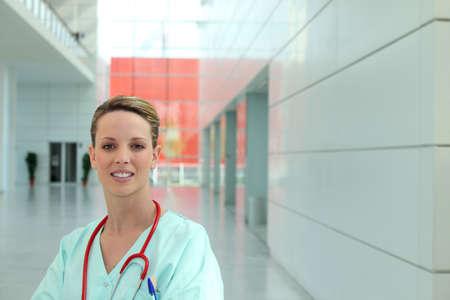 admission: portrait of female nurse in hospital corridor