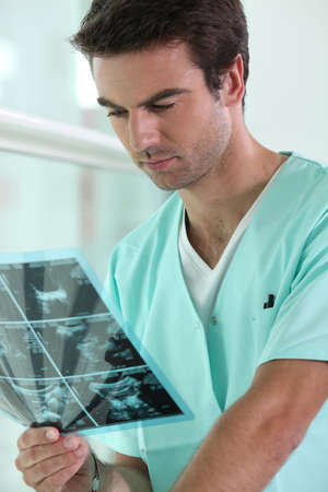 imaging: Doctor examining an x-ray