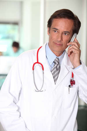 consultant physicians: Hospital doctor using a cellphone