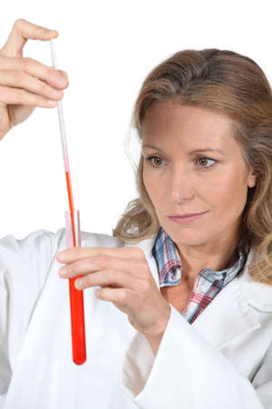 precipitate: female scientist with a test tube