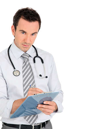 GP writing notes on a clipboard Stock Photo - 11947892