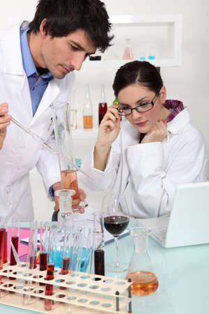 analysing: Oenologists analysing different wines