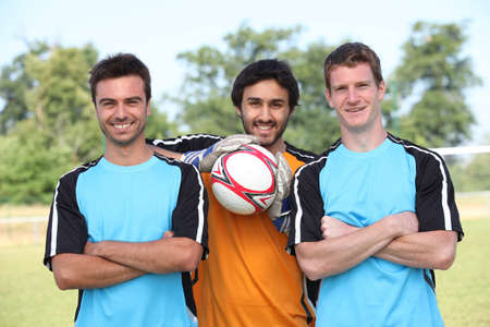 soccer players: Football player pausing to have their picture taken Stock Photo