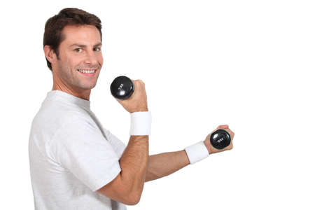 Man working out with hand weights photo