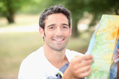 dark haired: young man with map Stock Photo
