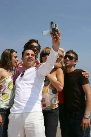 Group of friends taking self-photo photo