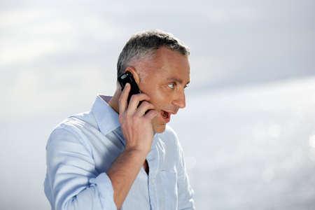 Surprised man talking on the phone