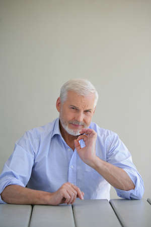 Elderly man giving the a-ok sign photo
