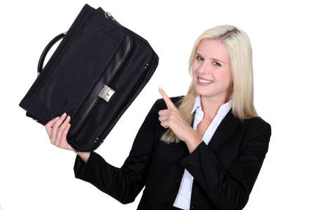 Businesswoman pointing to her briefcase photo
