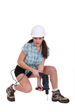 25 30 years women: Sexy woman using a power tool Stock Photo