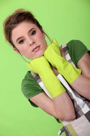 Homemaker wearing rubber gloves photo