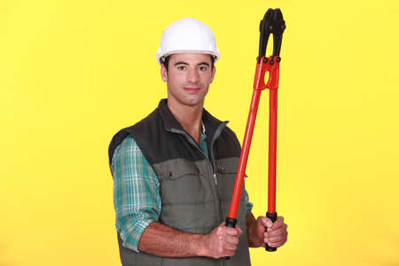 Man with boltcutters Stock Photo - 11947682