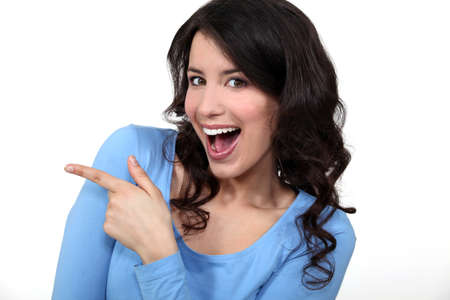 banter: Woman pointing and laughing Stock Photo