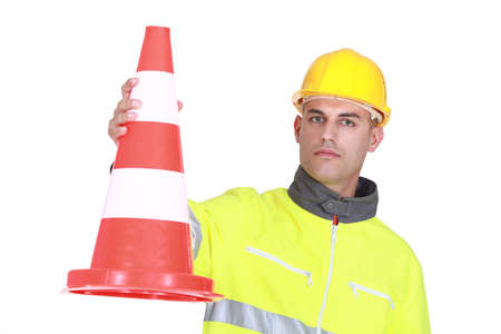 Worker with a traffic cone photo