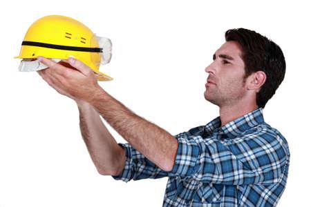 Man holding up a construction helmet Stock Photo - 11947836