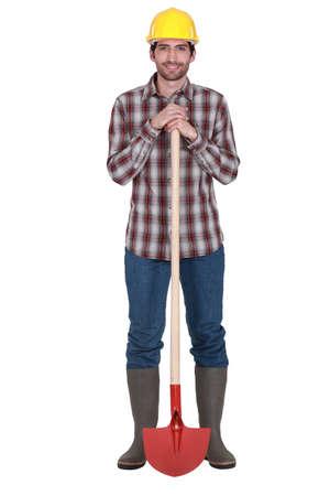 power shovel: A construction worker with a shovel.
