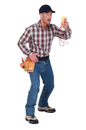 banter: Angry man looking voltmeter Stock Photo
