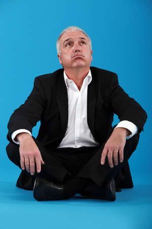 lack of confidence: Bored businessman sat on the floor