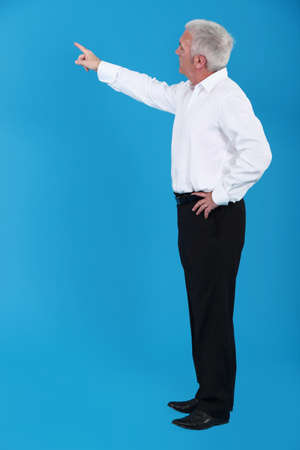grey haired: Grey haired teacher pointing Stock Photo