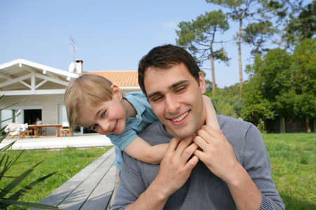 Father and son playing in the front yard Stock Photo - 11947239