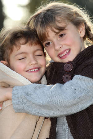 resemblance: Sisters hugging