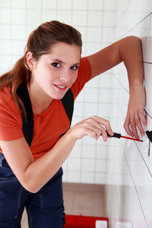 laborers: female electrician working