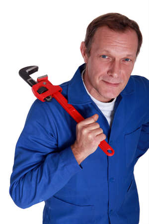 Plumber with a large adjustable wrench photo