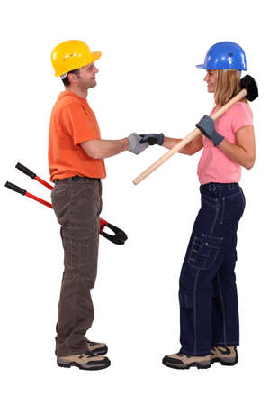 craftsman and craftswoman shaking hands Stock Photo - 11969984