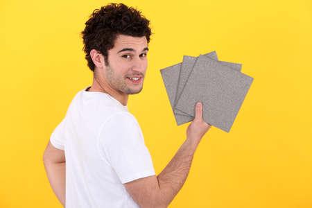 portrait of handyman installing tiles photo
