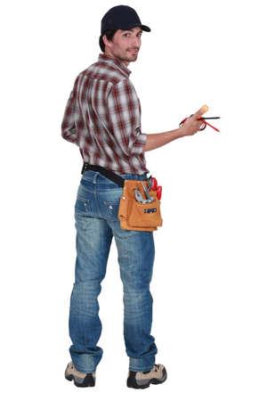 craftsman: Vista trasera de un electricista