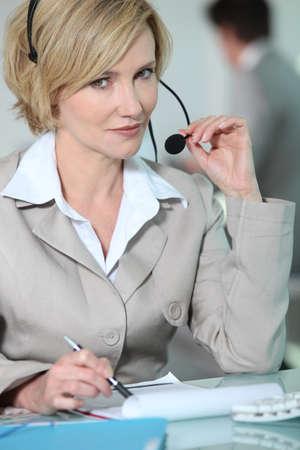 Woman holding headset. photo