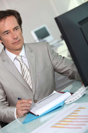 45 49 years: Executive working at computer